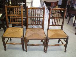 wooden chairs with newly caned seats