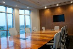 polished table in an office conference room