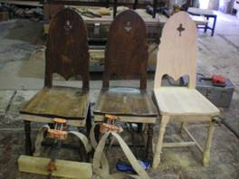 wooden chairs clamped while refurbishing