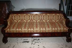 refinished wooden bench with ornate upholstery