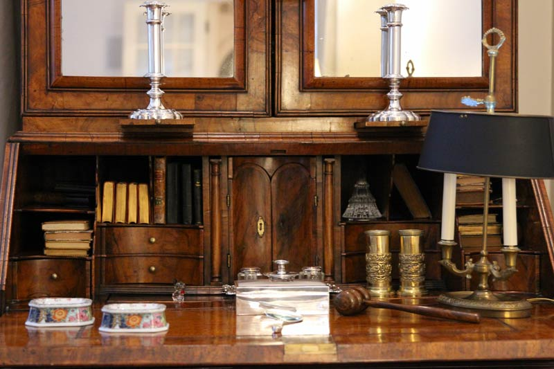 refinished desk with gavel, lamps, and sterling silver candle holders