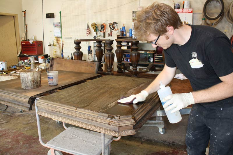 Georgetown Refinishing & Antique Restoration refinishing an antique table