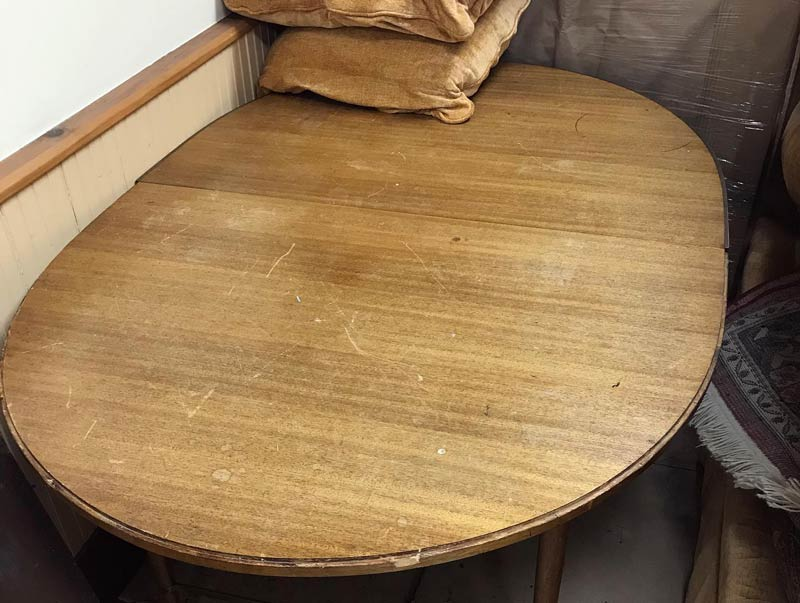 scratched wooden table in need of refinishing