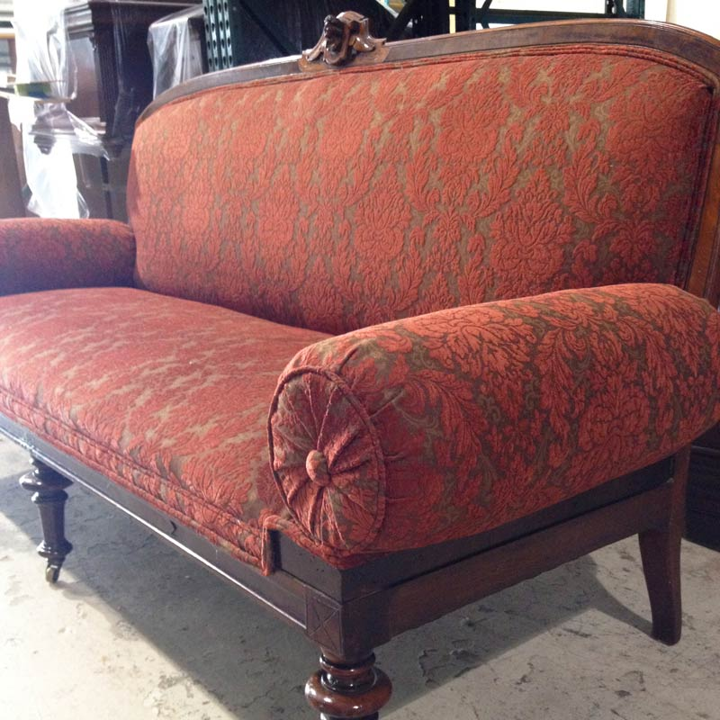 refinished 1860s sofa with red upholstery