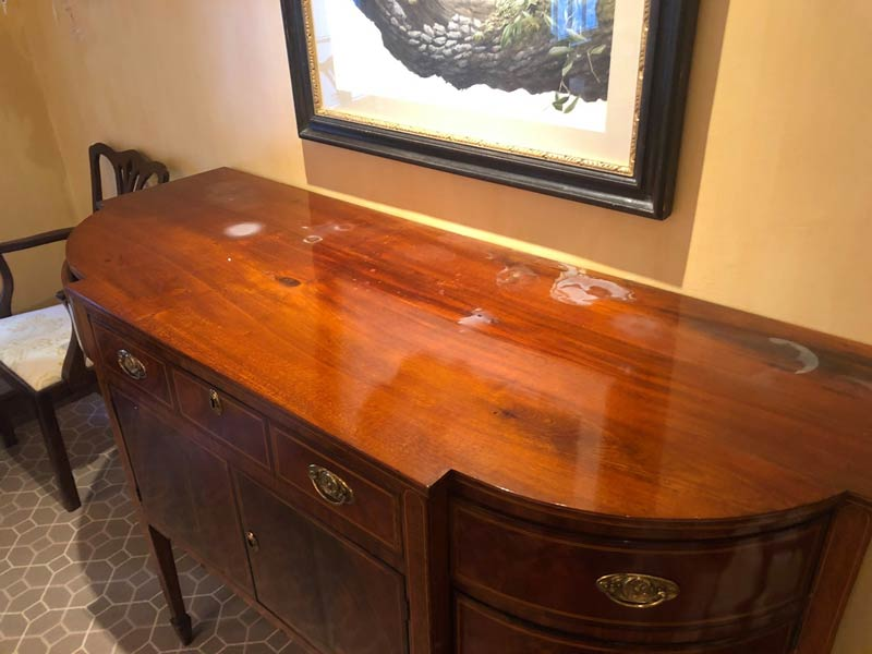 stained and scratched antique buffet