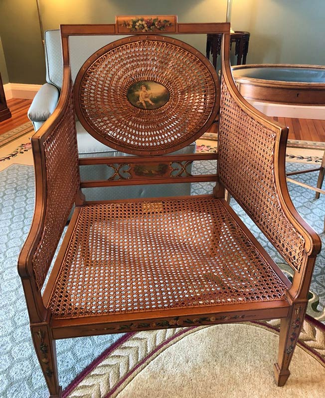 warped caning in a wooden chair